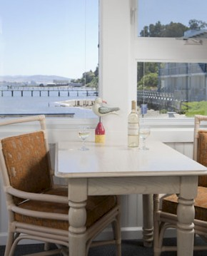 Dining table with wine for two with view of the bay